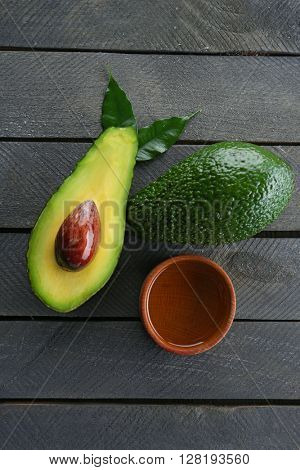 Fresh avocados  on wooden table, top view
