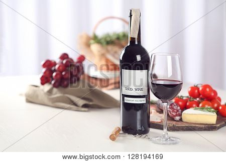 Glass of wine with food on blurred background