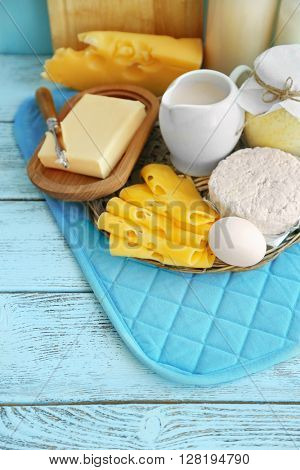 Set of fresh dairy products on blue wooden table, close up
