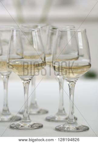 Glasses of white wine on table closeup
