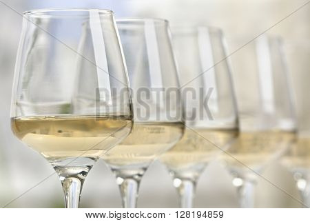 Glasses of white wine closeup