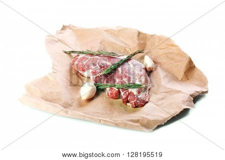 Raw pork steak with spices, isolated on white