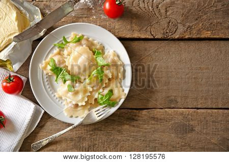 Cooked ravioli and tomatoes on plate