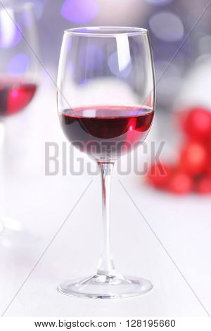 Wineglasses on blurred lights background