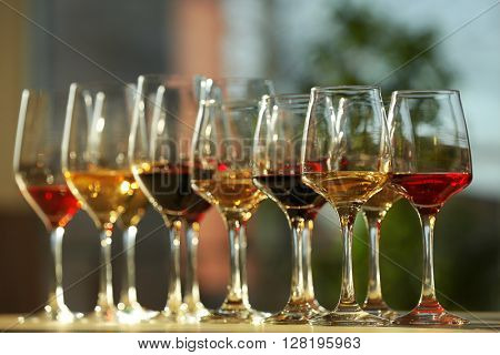 Many glasses of different wine in a row