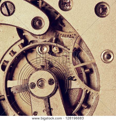 Old clock mechanism with cogwheels macro