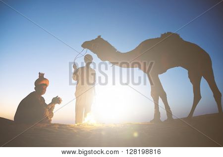Two Indigenous Indian Men With Their Camel Concept