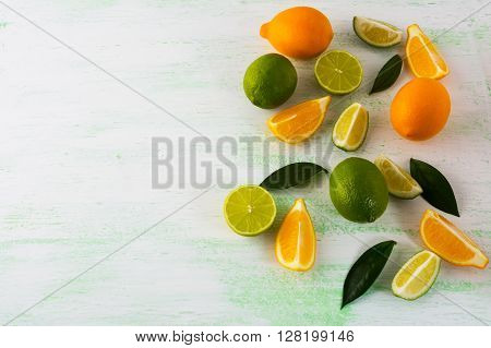 Lime and Lemon on light green background. Fruit background. Mixed fruit. Fresh fruit. Fresh food. Ripe fruit. Citrus fruit. Vegetarian food