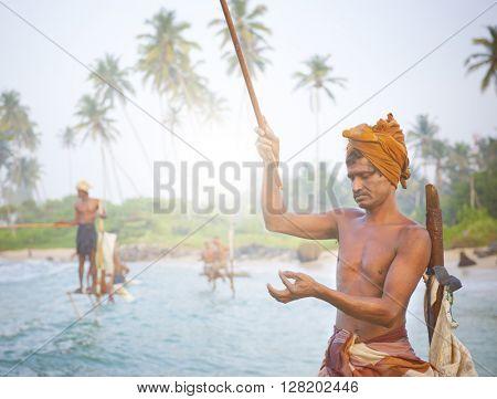 Stilt fishermen in Sri Lanka Concept