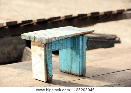 Small wooden stool.