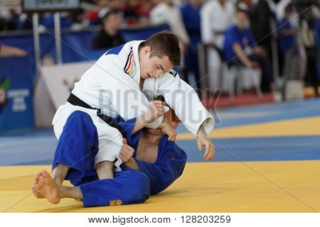 ST. PETERSBURG, RUSSIA - APRIL 16, 2016: Fight Leon Philipp of Germany vs Dmitry Karpukhin of Russia during the Junior European Judo Cup. 346 athletes from 22 countries participated in the competition