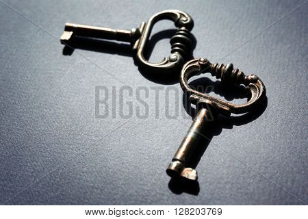 Vintage keys on dark blue background