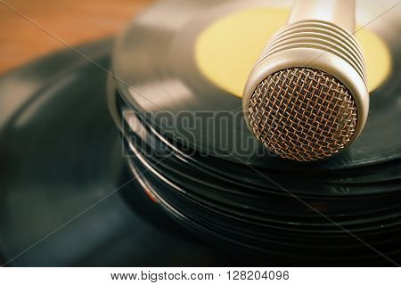 Stack of old vinyl records microphone, close up
