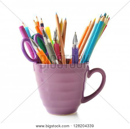 Colorful stationery in purple cup, isolated on white