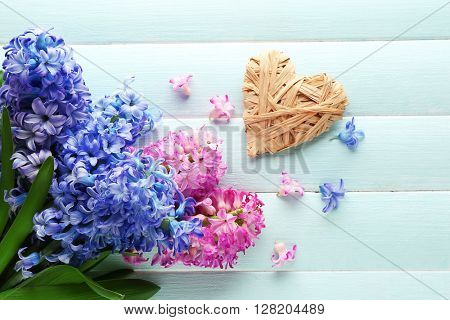 Bouquet of hyacinth and decor on wooden background