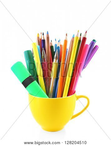 Colorful stationery in yellow cup, isolated on white