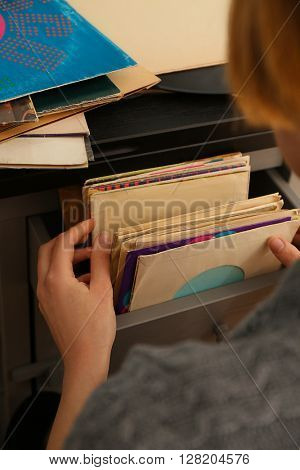 Woman chooses vinyl records