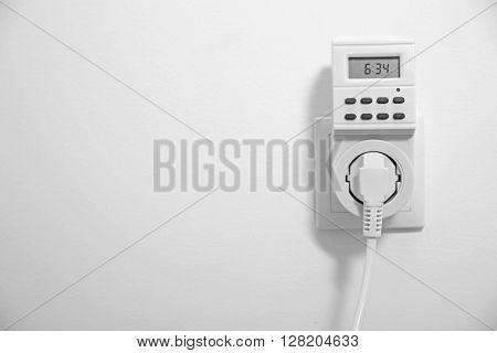 Electric plug in socket
