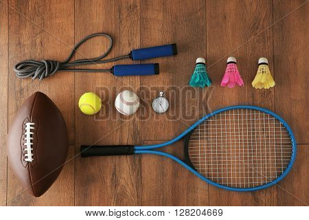 Sport equipment on wooden background
