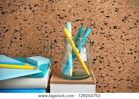 Stationery on cork board background.