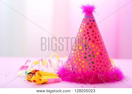 Party hat on bright background