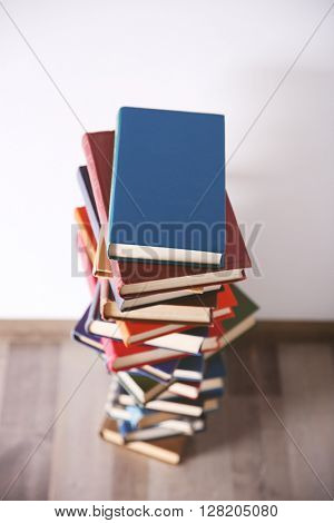 Pile of books on wall background