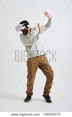 The picture in virtual reality glasses seems so real to the young man that he is even scared