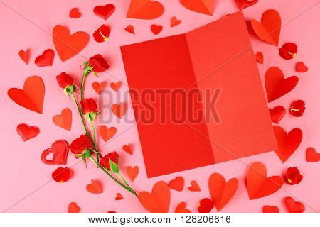 Valentine's card and decor on pink background, top view