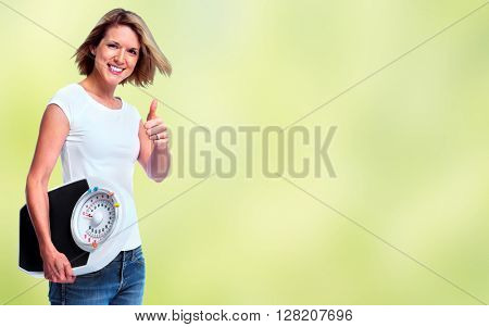 Woman with scales over green background.