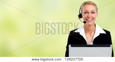 Smiling agent woman with headsets and laptop.