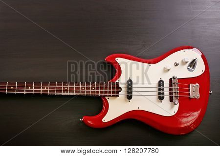 Electric guitar on black wooden background