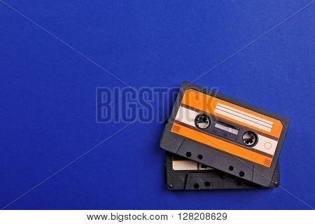 Old audio cassettes on blue background
