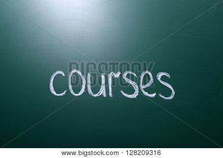 Courses inscription written with white chalk on blackboard