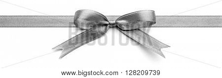 Silver silk ribbon with beautiful bow isolated on white background