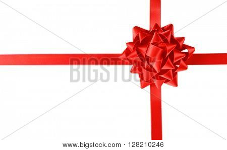 Red bow with crossed ribbon isolated on white background
