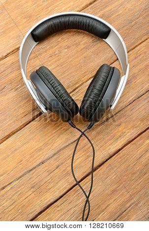 Big headphones on wooden table