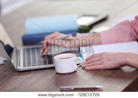 Businesswoman typing on keyboard in office