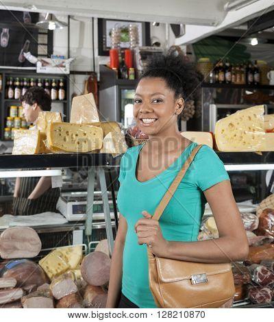 Portrait Of Happy Woman In Grocery Store