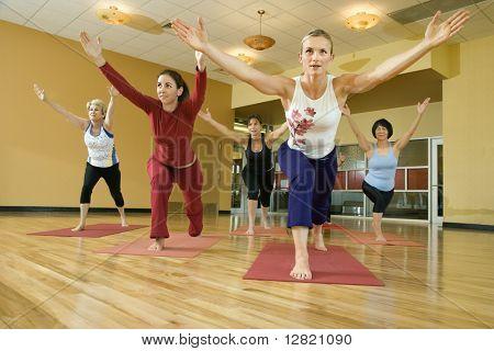 Prime adult female Caucasians in yoga class.