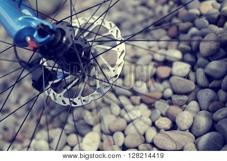 Mountain bike abstract front disc brake, forks and spokes