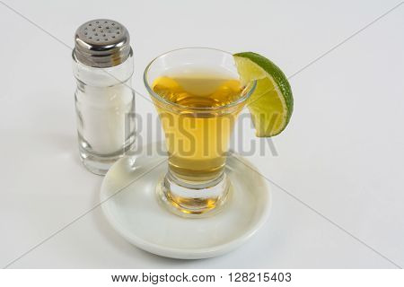 Tequila with lime on the white background. Tequila shot. Gold Mexican tequila. Tequila