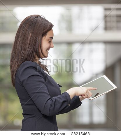 Beautiful businesswoman working with a tablet computer at the office