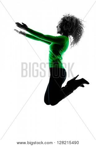 woman silhouette isolated jumping happy