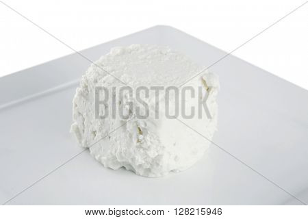 whole white light feta cheese on dishware