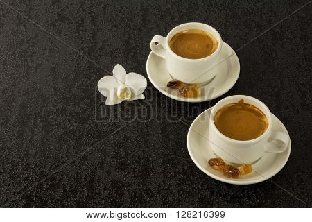 Two white cups of strong morning coffee. Morning coffee. Cup of coffee. Coffee cup. Coffee break