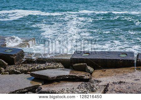 big waves on rocky coast and blue sea
