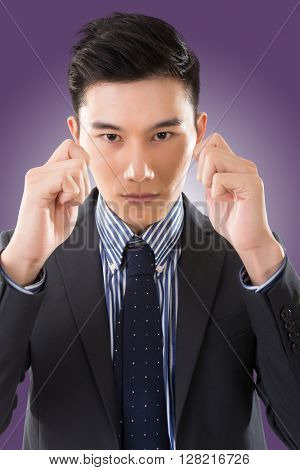 holding something on face, closeup portrait of Asian businessman