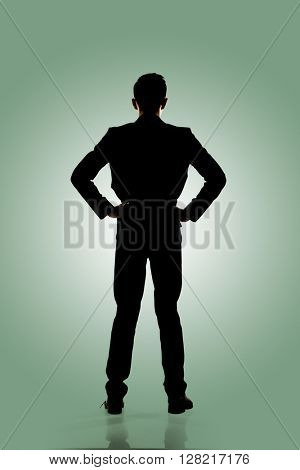 Silhouette of business man standing, full length portrait isolated.