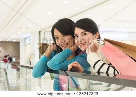 Excite woman go shopping with her friend in department store
