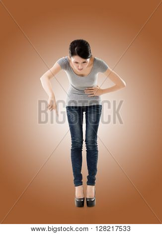 pose of Asian young woman holding or pointing something